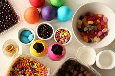 Empty eggs  - dye with food colours - fill and tape hole - turn over into cupcake papers.