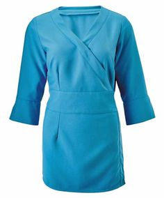 Women's sleeve wrap tunic for a distinctive and professional appearance in the beauty industry. Features a mock wrap over front and mock obi belt. Distinctive notched cuffs on sleeves. Made in soft touch polyester and available in a range of colours. Beauty Tunics, Salon Wear, Beauty Uniforms, Obi Belt, Uniform Design, Beauty Spa, Beauty Industry, Fitness Fashion, Work Wear