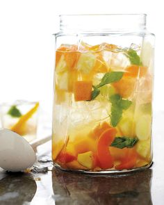 Summer Fruit Sangria | Martha Stewart Living - For a more festive Mother's Day celebration, get the party started with a pitcher of sangria made with white wine, fruit, and liqueur.