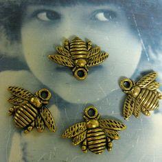 Cast Bumblebee Charms Bzzzzz Antique Brass finish 312RAW x4. $1.95, via Etsy.