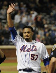 New York Mets starting pitcher Johan Santana (57) waves to fans after throwing a no-hitter against the St. Louis Cardinals in a baseball game on Friday, June 1, 2012, at Citi Field in New York. The Mets won 8-0, this was the Mets first no-hitter ever.