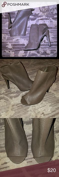 NWT faux leather peeptoe bootie! Brand new open toe perforated booties! They are kind of a taupe/Brown color, very cute shoes, I just have never worn them, they are a little high for me now these days, as heel is about 4 inches! Perfect for a vacation or spring coming up! Wet Seal Shoes Ankle Boots & Booties