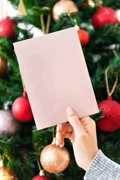 Woman holding a pink Christmas card in front of a Christmas tree mockup | premium image by rawpixel.com / Jira Creative Christmas Cards, Christmas Card Crafts, Pink Christmas, Christmas Greeting Cards, Christmas Photos, Christmas Greetings, Christmas And New Year, Christmas Time, Christmas Decorations