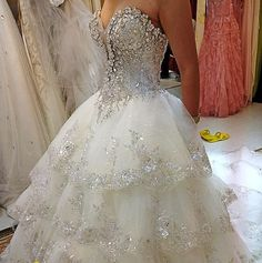 This is gorgeous, but I would change the bodice to be just plain, tule, and keep the bust exactly as it is. And have a rhinestone simple crown with cathedral length vale. That would be my dream dress!