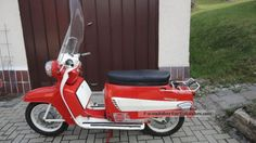 Jawa Tatran. The influence of the Lambretta is apparent with the addition of some styling cues from North American cars from the 50's and 60's.