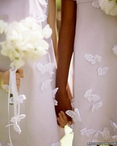 """See the """"Flower Girl Dresses""""Flower girls look enchanting with butterflies fluttering on their dresses. The appliques are easy to attach with a needle and thread. Ribbons streaming from their bouquets are decorated with the same butterflies,"""