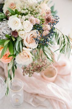 floral arrangement with roses and berries - photo by Tamara Gruner Photography http://ruffledblog.com/organic-blush-wedding-inspiration