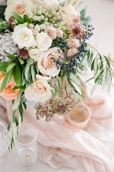 floral arrangement with roses and berries - photo by Tamara Gruner Photography http://ruffledblog.com/organic-blush-wedding-inspiration