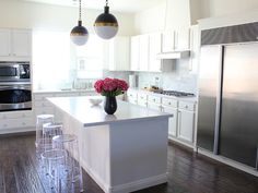 Lovely white kitchen with eclectic accents.