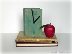 book clock    Will have to ditch the apple if I ever try this, cool for a future office or den