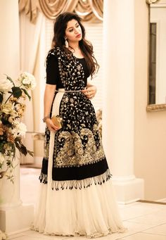 I am loving the trending fashion of lehngas/flowy skirts like any other girl! This trend has made a mark on the Pakistani fashion industry since the past couple of years. This beautiful, ivory ski… Indian Gowns Dresses, Indian Fashion Dresses, Dress Indian Style, Indian Designer Outfits, Dress Fashion, Simple Pakistani Dresses, Dresses Dresses, Designer Dresses, Fashion Outfits