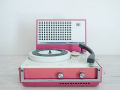vintage dusty pink portable electric record player.