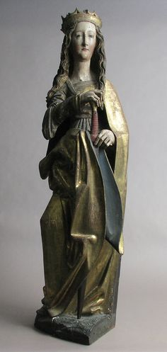 Antique Saint Catherine statue from the 15th–16th century. Lime wood with paint and gilding.