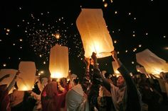 LIGHTING UP THE SKY: Women take part in a record breaking attempt for the most sky lanterns flown simultaneously in Jakarta, Indonesia