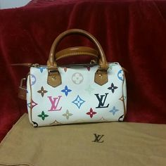 """Louis Vuitton Monogram multi color mini speedy Authentic Louis Vuitton Monogram multi color mini speedy.  This little baguette is perfect for going out on the town to carry the essentials with you.  Measures 7"""" x 4.5 """".  In great shape inside and out. The leather is soft and bright,  no fading or cracking.  The inside is stain free. Has a lock #313, but I have not located the key yet. Ha, Most people won't need it. The handles are dark,  like on most Louies,  but that is to be expected from…"""