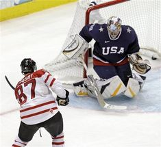 Canada's Sidney Crosby (87) shoots past USA goalie Ryan Miller (39) for the game-winning goal in the overtime period of a men's gold medal ice hockey game at the Vancouver 2010 Olympics in Vancouver.
