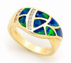 This charming 14k Yellow Gold Solid Inlay Opal Ring has an bold design which is unparalleled in its craftmanship. To craft this daring piece, our master jeweller match together the finest Australian light crystal opal from quality opal mines in Coober Pedy, South Australia, and hand cut them into appropriate size and shape before being set into a 14K Yellow Gold setting. Light up your look with this stunning jewellery! #opalsaustralia