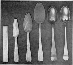 """From Strip of Metal to Finished Spoon: From left to right, these six stages show the principal steps followed by Early American silversmiths in spoonmaking. It started with the strip of rolled silver at the left. Next, shaping of the bowl and handle was started and continued through three stages. Then with a punch and die the bowl was """"struck up"""" that is, made concave and the handle was given its proper curve.  This set of steps follows the design of a Paul Revere spoon made about 1770."""