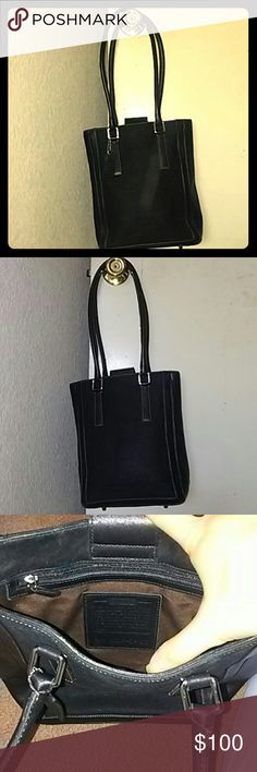 Used Coach Leather and Canvas Hamptons tote used coach handbag but in good condition. White stitching. Leather along the border  and on the straps and label. 100% authentic.  Has a side zipper inside. Black leather strap with magnetic closure.   Dimensions 10x10 1/2x4 inches. Coach Bags Shoulder Bags