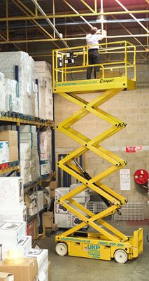 COMPACT 8 SCISSOR 8.18M -  This compact scissor allows passage through standard doorways, and is driveable at full height and features pothole protection.   #toolhire #equipmenthire #hss #hsshire #access #poweredaccess #scissorlift #scissorlifthire #scissorlifts