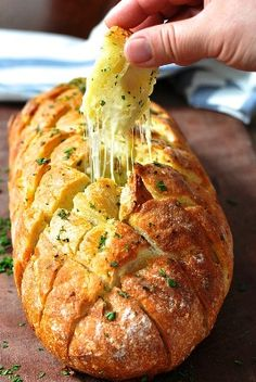 Cheese & Garlic Crack Bread 1 loaf of sourdough or Vienna bread ¾ Cup shredded Mozzarella Cheese 3.5 oz Unsalted butter, softened 2 garlic cloves, minced ½ Tbsp fresh parsley, finely chopped