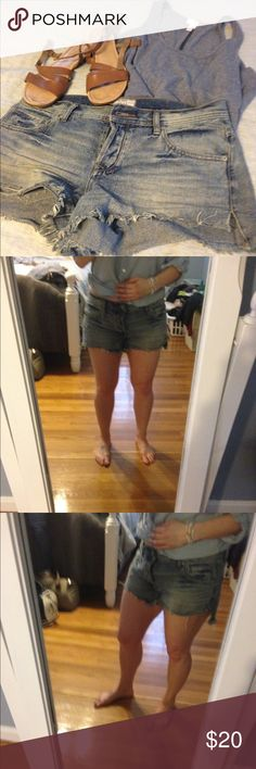 """Free People sharkbite denim cutoffs sz 28 Worn a handful of times before these got too big for me. Great condition Free People sharkbite denim cutoffs size 28 with button fly. 100% cotton. I think these could fit a size 29. 2.5"""" inseam; bank of shorts a little bit longer than the front and there's a side split. Makes these really comfortable for short shorts. Free People Shorts Jean Shorts"""