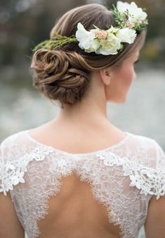 Place your floral accents off balance to the side, making it more like a hair clip. When worn with delicate lace shoulders, it is beyond ethereal. See more of this bridal look here. PC: Christie Graham Photography