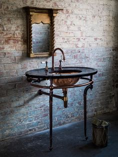 The Kinross Washstand by Catchpole & Rye in antiqued copper and black Nero marble. #luxury #bathroom #design