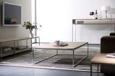 www.woonreijk.nl - De elegante salontafel Thin Coffee table is perfect voor in je interieur. Met zijn strakke lijnen en onderstel in eigentijds roestvrijstaal gecombineerd met een dun eikenhouten blad, is dit functionele meubel een genot voor het oog. (Ethnicraft)