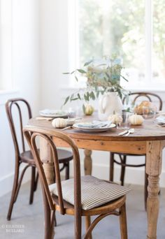 Country style. Round pine dining table. all white.