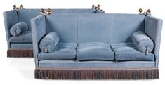 Sotheby's A pair of blue chenille upholstered 'Knowle' sofas, each with three loose cushions and two bolsters