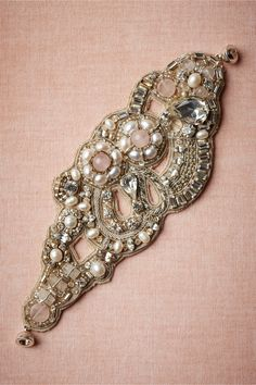"Swirls of pearls and streams of quartz eddy and flow over an organic tide of silk taffeta. A Ranjana Khan original, designed exclusively for BHLDN. 6""L, 2.25""W. Silver-plated brass magnetic closure. Glass, river pearls, rose quartz, silk taffeta. Imported."
