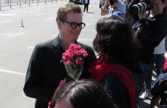 Colin Firth was taken by surprise when a fan gave him a bouquet of roses and a kiss on the cheek! The 56 year old actor was happily signing autographs for fans when the female fan handed him the flowers. At first he said he couldnÕt take them as he wouldnÕt be able to take then with him but the fan insisted and then as he walked away she cheekily gave him a kiss on the cheek! The British actor famously played Mr. Darcy in Jane AustenÕs Pride and Prejudice and has had female fans after him…