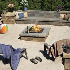 A firepit surrounded by sand just like a bonfire at the beach!