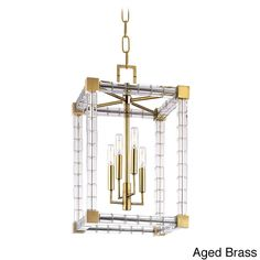 This fixture is made of metal. Comes in aged brass and polished nickel.