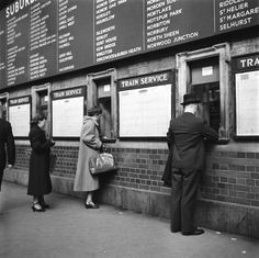 Passengers, buying, tickets at, Victoria, Station, London, 1951.
