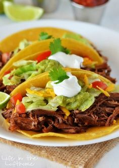 """Crock Pot Shredded Beef Tacos - """"Delicious and flavorful beef that slow cooks all day. These are incredible!"""" 