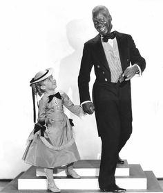 """Shirley Temple and Bill 'Bojangles' Robinson in a still from """"The Little Colonel,"""" 1935"""