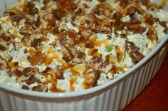 8 snickers bars 4 green apples 1pkg vanilla pudding 1/2 c milk 16oz tub of cool whip carmel ice cream topping