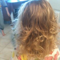My 3 year old's baby fine hair curled using the sock bun method.  Click for tutorial :)