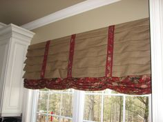 Kitchen window treatment but use burlap coffee seed sacks instead..