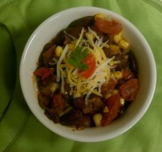 Vegetarian Chili perfect crowd pleaser. Vegan option by omitting cheese as a topping.