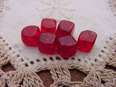 Check out this item in my Etsy shop https://www.etsy.com/listing/488125731/garnet-red-crackle-cubes-vintage-glass