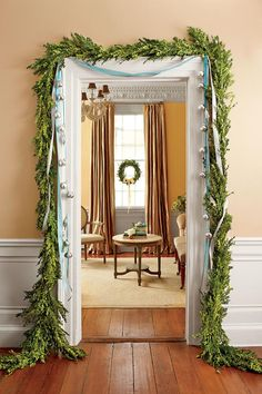 to Deck Your Halls? Southern Christmas Essentials: The DoorwaySouthern Christmas Essentials: The Doorway Christmas Greenery, Christmas Lights, Christmas Wreaths, Christmas Decorations, Holiday Decorating, Christmas Arch, Christmas Trimmings, Winter Wreaths, Christmas Flowers