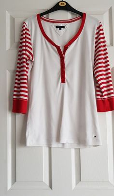 Super cute and light weight top that'll go great with any outfit! White Tops, Red And White, Designing Women, Fashion Clothes, Tommy Hilfiger, Tunic Tops, Clothes For Women, Link, Casual