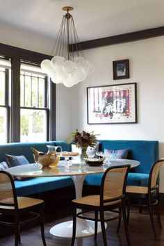 Custom blue banquette, Josef Hoffmann chairs, a Matisse print, a Saarinen table and an Apparatus light fixture Dining Nook, Round Dining Table, Dining Room Design, Home Design, Interior Design, Saarinen Table, Tulip Table, Banquette Seating, Corner Banquette