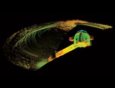 """""""About 250 years before work began on Egypt's ostentatious Great Pyramid of Giza, the early settlers of Orkney, off the north coast of Scotland, were building impressive stone chambers of their own - and burying them under mounds of dirt. Now, intensive laser scanning makes it possible to virtually peel away the mud, revealing one of those chambers in all its glory."""""""