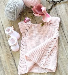 **** ALL PDF KNITTING PATTERNS ARE IN ENGLISH ONLY **** Description Listing for KNITTING PATTERN ONLY - Lil' Rosebud seamless top down dress / tunic top - P112 This seamless little top down dress / tunic top is an easy knit, worked in garter stitch with a simple leaf pattern forming the