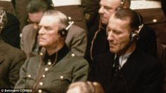 Ernst Kaltenbrunner (right), pictured with Wilhelm Keitel at the Nuremberg Nazi war crimes trials. His influence led to the art being saved....