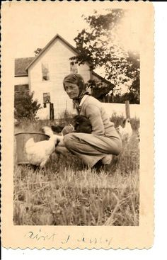 "Sarah Margaret Sawyers feeding her chicks while holding her kitty cat =^0^= ""Ain't I purdy"" is what the caption reads."